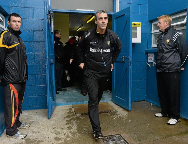 Donegal boss Jim McGuinness makes his way out of the dressing room before the Ulster semi-final against Down - a game which Eugene McGee has identified as the start of their downfall