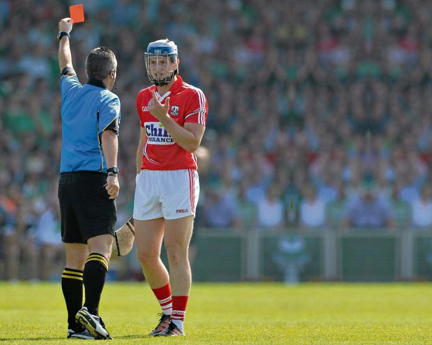 Cork's Patrick Horgan is shown a straight red card by referee James McGrath