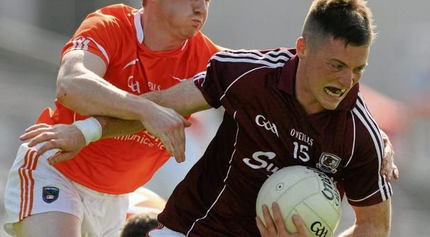 Galway's Danny Cummins in action against Paul McKeown