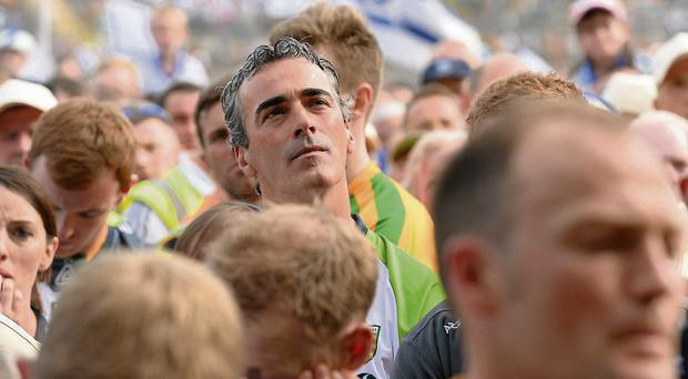Donegal manager Jim McGuinness in deep thought as he looks up at the post-match presentation