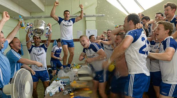 Monaghan players celebrate in the team dressingroom after defeating Donegal in yesterday's Ulster SFC final