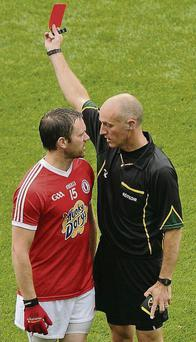 Martin Penrose, Tyrone, gets a red card from referee Cormac Reilly