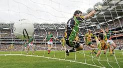 Cillian O'Connor, Mayo, right, scores his side's fourth goal past Donegal goalkeeper Paul Durcan