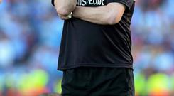 Mayo manager James Horan and captain Andy Moran cut disconsolate figures following their defeat to Dublin