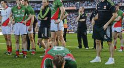 A devastated Aidan O'Shea takes a moment to himself on the Croke Park pitch
