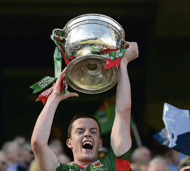 Mayo captain Stephen Coen lifts the Tommy Markham Cup