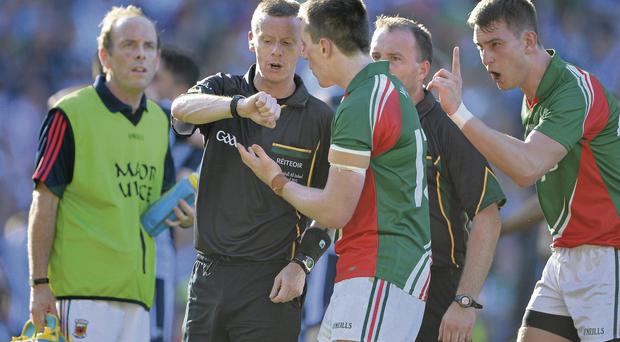 Mayo's Cillian O'Connor and Barry Moran confront referee Joe McQuillan as he looks at his watch after the final whistle was blown at Croke Park yesterday.
