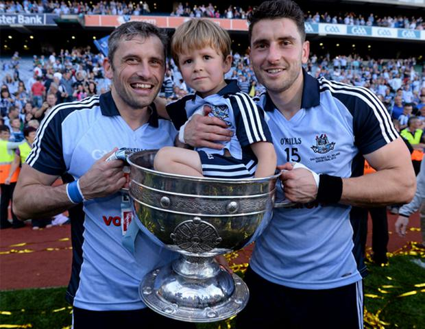 Dublin's Alan Brogan, his son Jamie, and goal hero Bernard Brogan with the Sam Maguire after the game