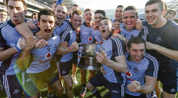 The Dublin players celebrate with the Sam Maguire trophy at Croke Park on Sunday
