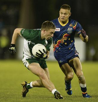 Ireland's Ross Munnelly takes on Leroy Jetta of Australia during the first Test on Saturday night