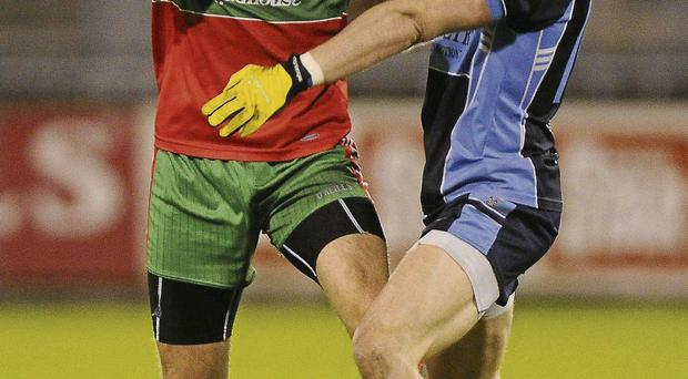 Ballymun's Kevin Leahy attempts to get past Mark Sweeney of St Jude's during their Dublin SFC semi-final in Parnell Park DAIRE BRENNAN/SPORTSFILE