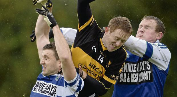 Dr Crokes talisman Colm Cooper is squeezed out by Castlehaven goalkeeper Paudie Hurley, right, and David Limrick during their Munster SFC club quarter-final STEPHEN MCCARTHY / SPORTSFILE