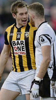 Johnny Hanratty of Crossmaglen Rangers exchanges words with Kilcoo's Paul Greenan