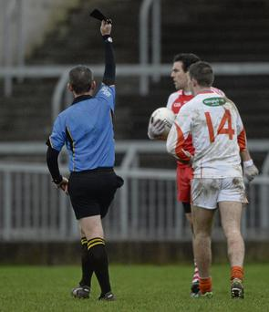 Referee Brendan Rice shows a black card during the O'Fiach Cup final between Armagh and Derry. Photo: Paul Mohan