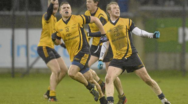 DCU's Gary Kelly celebrates after team-mate David Byrne, left, scored their side's winning point against Dublin at Parnell Park