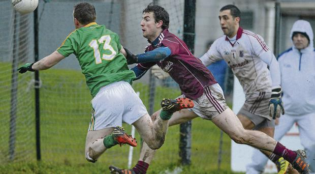 Leitrim's Ray Cox scores his side's first goal past Galway's Paddy Maguire and goalkeeper Nathan King Diarmuid Greene / SPORTSFILE