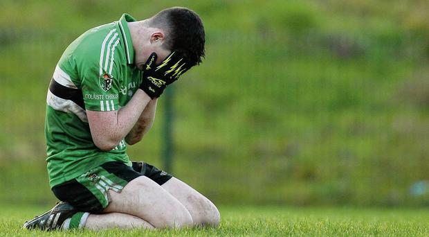 Darragh Kerins of Colaiste Chriost Ri falls to the ground after losing to Pobalscoil Chorca Dhuibhne