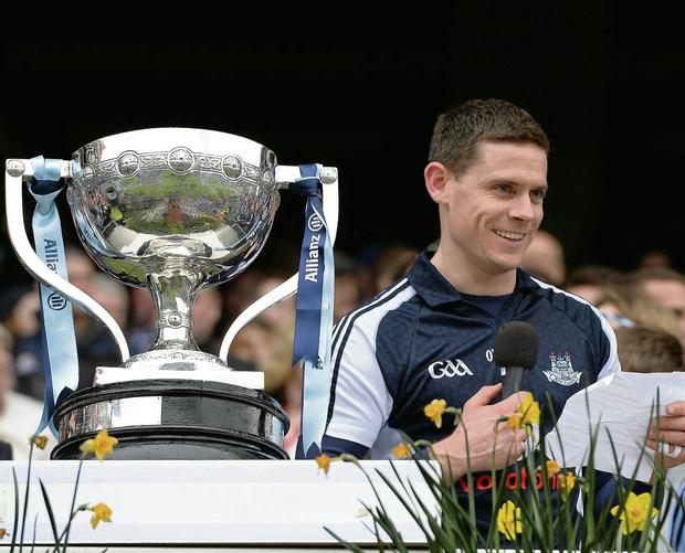 Dublin goalkeeper and captain Stephen Cluxton prepares to read his speech in acceptance of the Allianz NFL Division 1