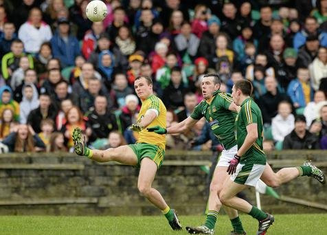 Donegal's Neil McGee gets his shot away under pressure from Meath's Andrew Torney during their Allianz NFL clash in Ballybofey