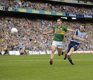 Kevin McManamon, Dublin, shoots to score his side's second goal