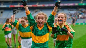 Eimear Ní Mhaoldomhnaigh and her Scoil Oilibhéir Coolmine team-mates celebrate after victory against Bracken Educate Together in the Corn Irish Rubies Cup during the Allianz Cumann na mBunscol Finals at Croke Park