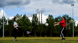Hannah Jacobs (9) passes to Katie Sheridan (10) as they practice their skills in Sean Moore Park, beside Clanna Gael Fontenoy club grounds in Sandymount, Dublin yesterday. Photo: Sam Barnes/Sportsfile