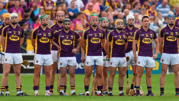 Wexford players stand for the national anthem before last year's SHC victory over Waterford