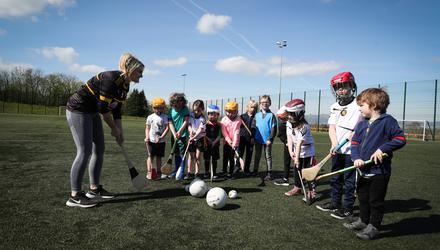 Coach Michaela Argue with children from East Belfast GAA club. Photo: Kelvin Boyes