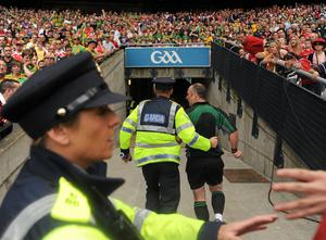 Referee Martin Sludden is given a Garda escort from the field at the 2010 Leinster final