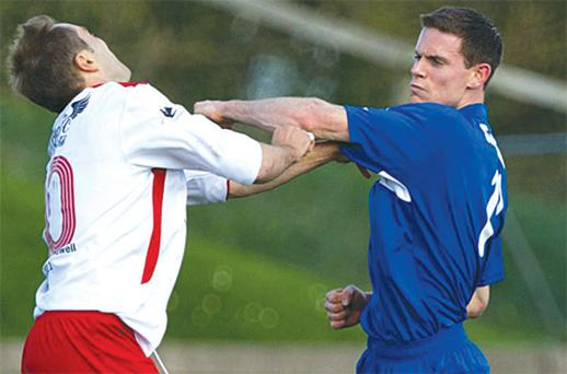 Stephen Cluxton punches Jason McAteer during a charity match in 2011