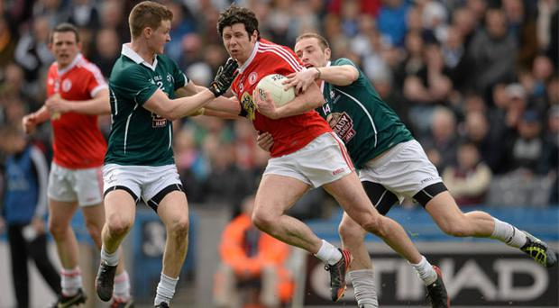14 April: Tyrone's Sean Cavanagh in action against Eoghan O'Flaherty, left, and Alan Smith, of Kildare. Tyrone beat Kieran McGeeney's men by four points in a hard fought game at Croke Park