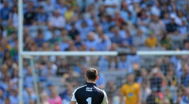 Dublin captain Stephen Cluxton takes a successful free kick late in the game