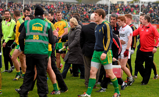 Tyrone and Donegal players and officials exchange words while leaving the field at half-time in Ballybofey last Sunday. Photo: Stephen McCarthy