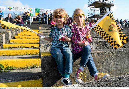 Mountbellew/Moylough fans and siblings James, age 3, and Katie, age 5, Connaughton ahead of the Galway Senior Football Final. Galway County Senior Football Championship Final,
