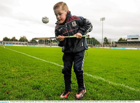 Galway supporter Fionn Kelly, age 6, from Co. Kildare, practices his hurling skills before the start of the match. Bord na Mona Walsh Cup, Semi-Final, Dublin v Galway, Parnell Park, Dublin. Picture credit: Seb Daly / SPORTSFILE