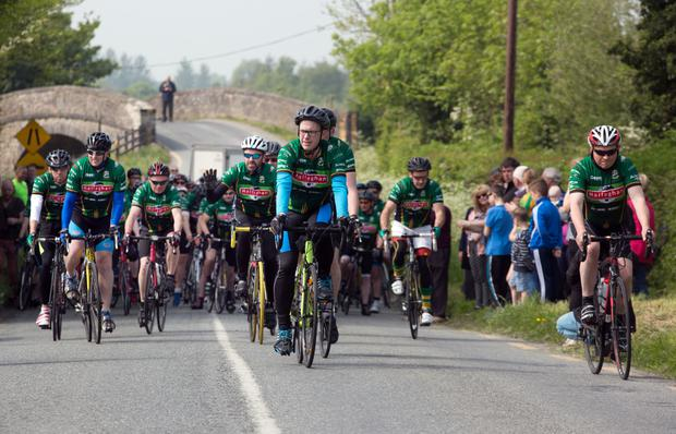 Members of St. Malachy's GAA club start their cycle to Edendork, Co. Tyrone from Healy's Bridge, Prosperous, Co. Kildare, the scene of the shooting.