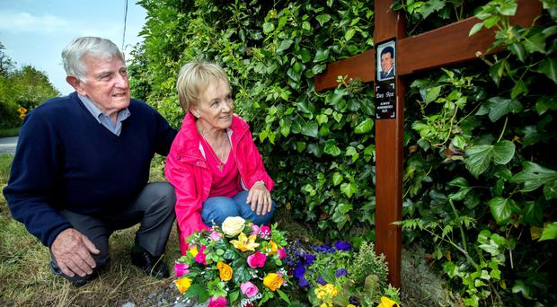 Dessie Fox's wife Bernadette and his brother Brian lay a wreath at Healy's Bridge, Prosperous. Photo: INM
