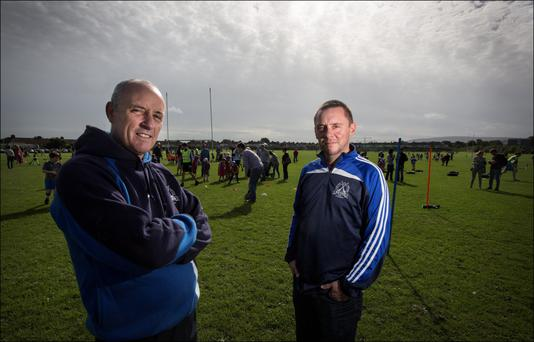 St Kevin's HC officials JJ O'Mahony and Vincent Hennessy at an underage training session at Templeogue Synge Street's facility. Photo: David Conachy