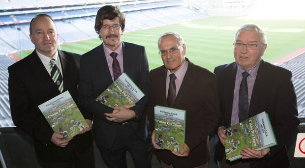John Hanniffy, Cheddar Plunkett and editors Teddy Fennelly and Brian Delaney at the launch of C'mon The Town, a history of Portlaoise GAA club. Photo: Alf Harvey
