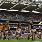 Kilkenny and Tipperary teams taking part in last September's All-Ireland SHC final pre-match parade - the new Club Players Association (CPA) want hurling's showpiece brought forward to July to free up more time for club fixtures. Photo: Sportsfile