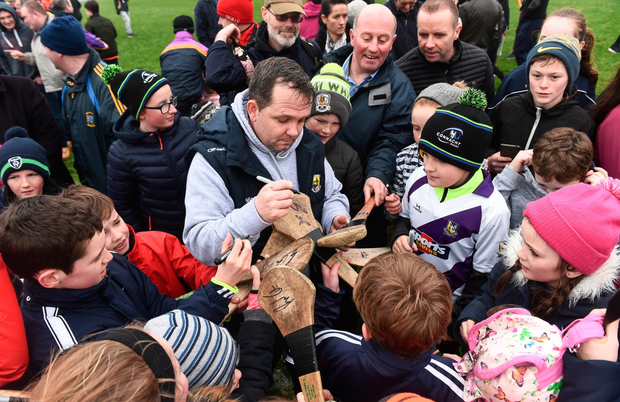Davy Fitzgerald signs autographs for supporters at the end of the Allianz Hurling League Division 1B clash against Galway Picture: Sportsfile