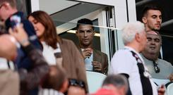 Cristiano Ronaldo is a face in the crowd at the Juventus Stadium in Turin as his team take on Young Boys