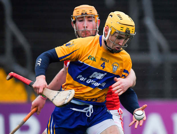 Clare's Rory Hayes is tackled by Cork's Declan Dalton during yesterday's Munster Hurling League match at Cusack Park. Photo: Sportsfile