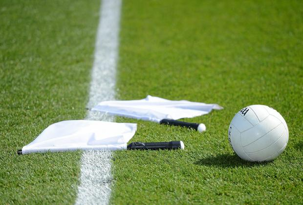 A general view of a gaelic football and linesmen flags.