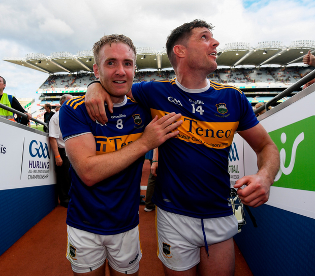 Noel McGrath embraces Seamus Callanan after Tipperary's victory. Photo: Ramsey Cardy/Sportsfile