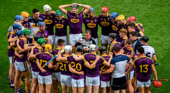 The Wexford players are captivated by Davy Fitzgerald's pre-match pep-talk ahead of this year's Leinster final against Kilkenny. Photo: Daire Brennan/Sportsfile