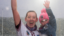 Louise Dougan celebrates with her daughter, Molly, after their All-Ireland final victory over St Martins last year. Photo: Harry Murphy. Photo: Sportsfile