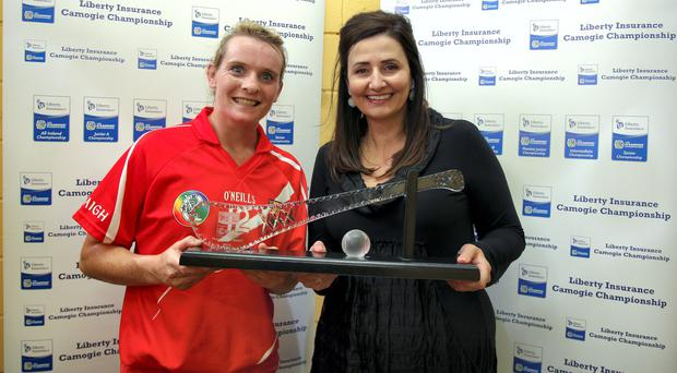 Cork's Briege Corkery is presented with the player of the match award by Annette N' Dhathalao' of Liberty Insurance