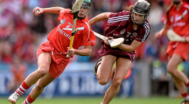 Julia White of Cork tries to escape the clutches of Galway's Siobhan Coen during yesterday's senior camogie final in Croke Park