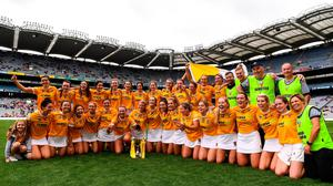Antrim players and staff celebrate with the Jack McGrath Cup after their All-Ireland Intermediate Camogie Championship final win over Kilkenny at Croke Park. Photo: Ben McShane/Sportsfile